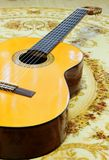 Classical guitar on the floor Stock Image