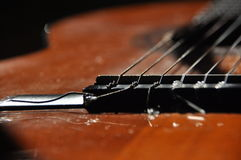 Classical guitar. Issuing a stringed instrument sounds. Fretboard, strings Stock Image