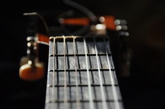 Classical guitar. Issuing a stringed instrument sounds. Fretboard, strings Royalty Free Stock Images