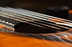 Classical guitar. Issuing a stringed instrument sounds. Fretboard, Royalty Free Stock Photo