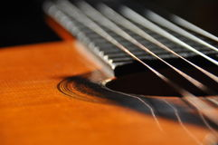 Classical guitar. Issuing a stringed instrument sounds. Fretboard, strings Royalty Free Stock Photography