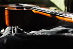 Classical guitar. Issuing a stringed instrument sounds. Fretboard, strings Stock Images