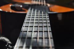 Classical guitar. Issuing a stringed instrument sounds. Fretboard, Royalty Free Stock Photos