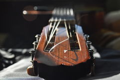 Classical guitar. Issuing a stringed instrument sounds. Fretboard, strings Royalty Free Stock Photos