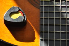 Classical guitar. Issuing a stringed instrument sounds. Fretboard, strings Stock Photography