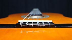 Classical guitar looking past bridge down the neck