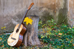 Classical guitar next to old wall Stock Image