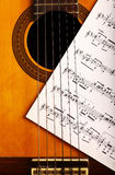 Classical guitar and notes Royalty Free Stock Photography