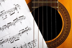 Classical guitar and notes Royalty Free Stock Photos