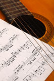 Classical guitar and notes Royalty Free Stock Image