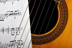 Classical guitar and notes Stock Photo