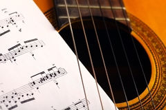 Classical guitar and notes Stock Images