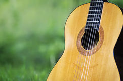 Classical guitar in park. Classical guitar leaning against tree in park royalty free stock photo