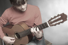 Classical guitar player details Stock Image