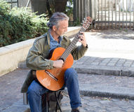 Classical guitar player in a Paris courtyard Royalty Free Stock Photos