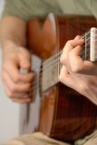 Classical guitar practice. Young male practicing on a classical guitar royalty free stock photography