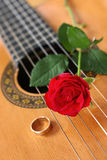 Classical Guitar & Red Rose. Classical guitar with a red rose and gold ring royalty free stock image