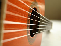 Classical guitar and strings. Guitar shot from side Stock Photography
