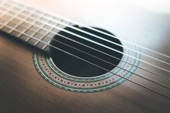 Classical guitar and strings, professional instrument. Cutout of a classical guitar corpus and strings, closeup music instrument entertainment professional royalty free stock images