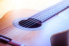 Classical guitar and strings, professional instrument. Cutout of a classical guitar corpus and strings, closeup music instrument entertainment professional royalty free stock photography