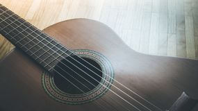 Classical guitar and strings, professional instrument. Cutout of a classical guitar corpus and strings, closeup music instrument entertainment professional stock image