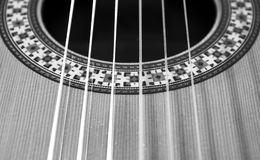 Classical guitar: strings and rosette. Black and white photo. A detail photo of a part of a classical guitar Royalty Free Stock Photography