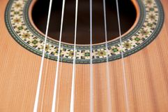 Classical guitar: strings and rosette. A detail photo of a part of a classical guitar with the strings and rosette Stock Photo
