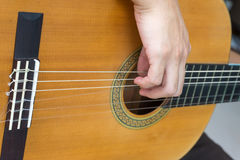 Classical guitar strings wiht fingers Royalty Free Stock Photo