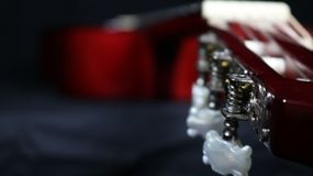 Classical guitar view from tuners to the body, with strong depth of field royalty free stock photos