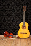 Classical guitar and violin Stock Photos