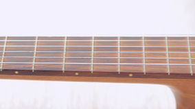 Classical guitar on white background stock video footage