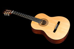 Classical guitar with yellow deck isolated on black Stock Photos