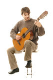 Classical guitarist guitar. Guitarist. Guitar playing. Young man playing classic acoustic six string guitar. Classical guitarist professional isolated on white Royalty Free Stock Photography