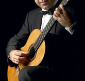 Classical Guitarist with Smoking Jacket Royalty Free Stock Photography