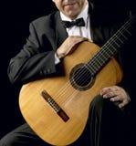 Classical Guitarist with Smoking Jacket Stock Photos