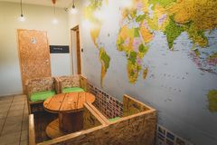 Classical Hostel interior. Stylish Room in a hostel with world map royalty free stock image