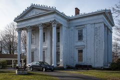 Classical house. White classical house, museum with car in front Stock Image