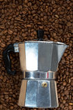 Classical Italian coffee maker pot with coffee beans Royalty Free Stock Photography