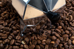 Classical Italian coffee maker pot with coffee beans Stock Images
