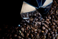 Classical Italian coffee maker pot with coffee beans Stock Photography