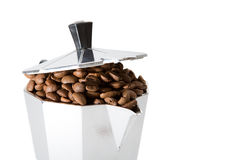 Classical Italian coffee maker pot filled with coffee beans Stock Images