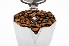 Classical Italian coffee maker pot filled with coffee beans Stock Photos