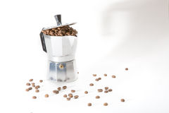 Classical Italian coffee maker pot filled with coffee beans Royalty Free Stock Photo