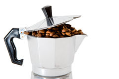 Classical Italian coffee maker pot filled with coffee beans Royalty Free Stock Images