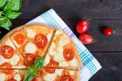 Classical Italian pizza `Margarita` with mozzarella, tomatoes, basil Stock Photos