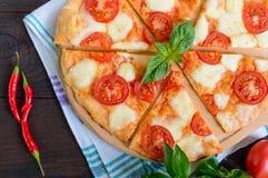 Classical Italian pizza `Margarita` with mozzarella, tomatoes, basil Stock Photography