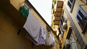 Classical Italian street with low cozy houses and laundry on balconies, sequence. Stock footage stock video