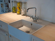 Classical kitchen sink with tap faucet. Details of modern classical design trendy  kitchen sink with water tap faucet Stock Photo