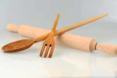 Classical kitchen symbol. Studio shot of wooden rolling pin,wooden fork and wooden spoon. Traditional cuisine concept Royalty Free Stock Photo