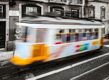 Classical Lisbon colorized touristic tram on the street, moving Stock Photos